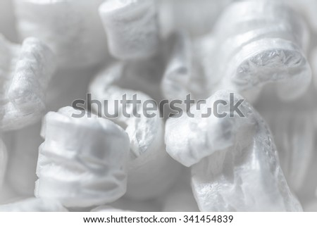 S shaped polystyrene packing chips macro. - stock photo