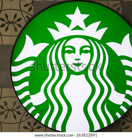 SA-THORN SQUARE BUILDING, BANGKOK, THAILAND - MAR 26, 2015 : Starbucks logo on antique backgrounds. Starbucks is the largest coffeehouse company in the world. at  Bangkok, Thailand. - stock photo