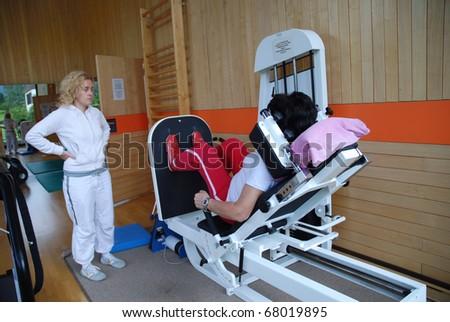 SAALFELDEN, AUSTRIA - AUGUST 30: physical therapist assisting female patient on August 30, 2007 at rehabilitation center in Saalfelden, Austria. - stock photo