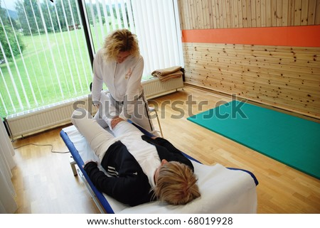 SAALFELDEN, AUSTRIA - AUGUST 30: physical therapist exercising with female rheumatism patient on August 30, 2007 at rehabilitation center in Saalfelden, Austria.