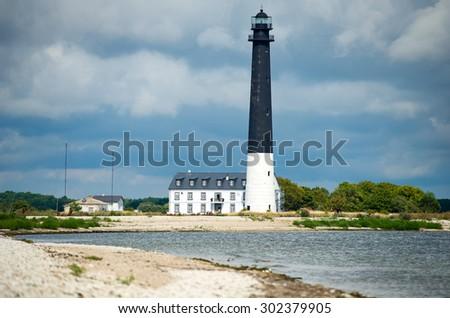 Saare Lighthouse. The main Southern lighthouse on island Saaremaa, Baltic Sea, Estonia, Europe. - stock photo