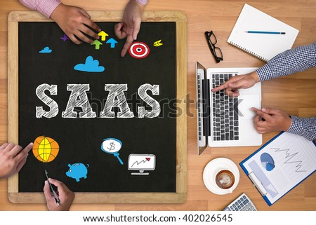 SAAS Businessman working at office desk and using computer and objects on the right, coffee,  top view, - stock photo