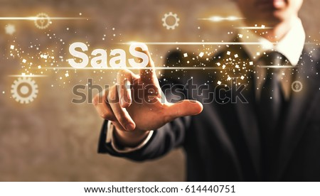 SaaS text with businessman on dark vintage background