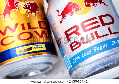 SABAH, MALAYSIA - JANUARY 13, 2015. Can of Red Bull and Wild Cow energy drink isolated on white.