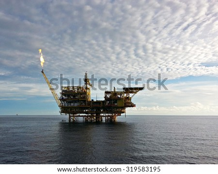 Sabah, Malaysia. May 14, 2014 : A silightly blurry image of an ofshore oil rig drilling platform off the coast of Labuan Federal Territory of Malaysia in late afternoon light.