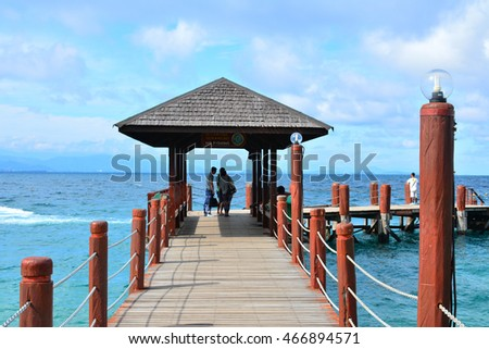 SABAH, MY - JUNE 20: Manukan Island footbridge on June 20, 2016 in Malaysia. The Manukan Island Resort is a hideaway that is one of the five tropical islands that comprise the Tunku Abdul Rahman Park.