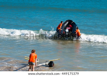 Sables-d-Olonnes, France - July 05, 2016 : french bay lifeguards (S.N.S.M, Sauveteurs en mer) put their boat in the water