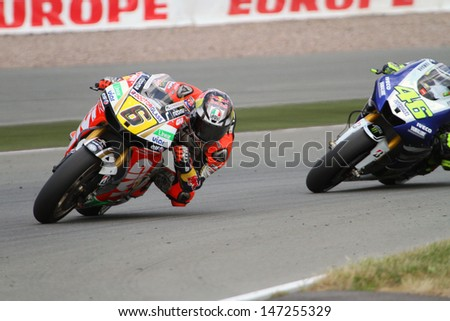SACHSENRING - GERMANY, JULY 14: German Honda rider Stefan Bradl leads Rossi at 2013 Eni MotoGP of Germany at Sachsenring circuit on July 14, 2013