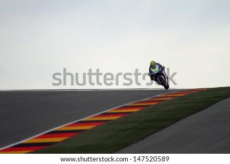 SACHSENRING - GERMANY, JULY 14: Italian Yamaha rider Valentino Rossi at 2013 Eni MotoGP of Germany at Sachsenring circuit on July 14, 2013 - stock photo