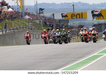 SACHSENRING - GERMANY, JULY 14: Race start at 2013 Eni MotoGP of Germany at Sachsenring circuit on July 14, 2013 - stock photo