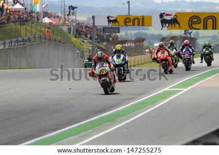 SACHSENRING - GERMANY, JULY 14: Race start at 2013 Eni MotoGP of Germany at Sachsenring circuit on July 14, 2013