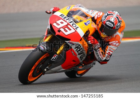 SACHSENRING - GERMANY, JULY 14: Spanish Honda rider Marc Marquez wins the 2013 Eni MotoGP of Germany at Sachsenring circuit on July 14, 2013 - stock photo