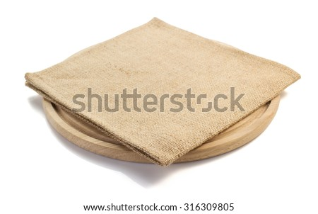 sack burlap napkin at cutting board on white background - stock photo