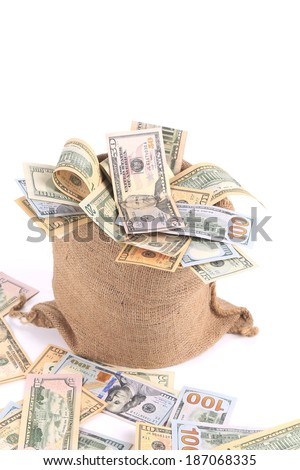 Sack full of american dollars. Isolated on a white background. - stock photo