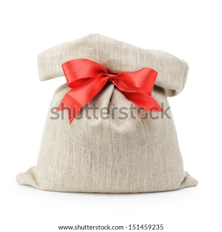 sack gift bag with ribbon bow, isolated on white - stock photo