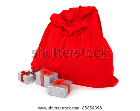 sack of Santa Claus and presents on white background - stock photo