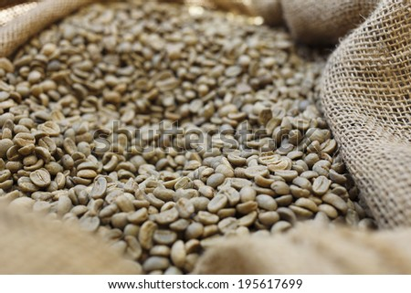 sack of un-roasted coffee - stock photo