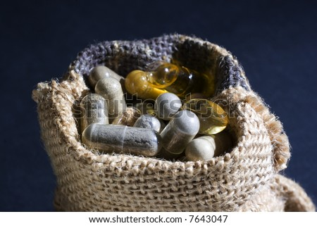 Sack pills in black background - stock photo