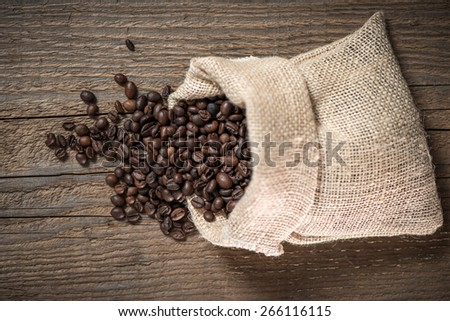 Sack with coffee beans - stock photo