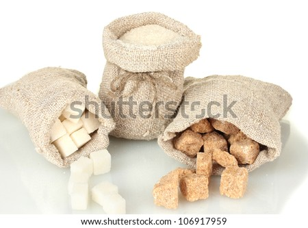 Sack with different types of sugar isolated on white - stock photo