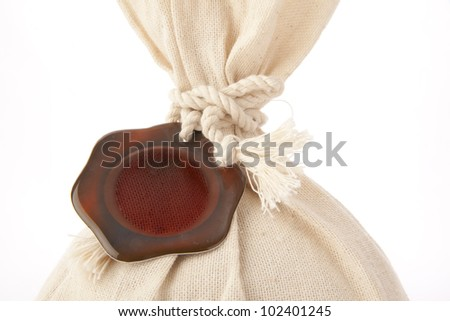 sack with money to place for your ads on a brown background currency isolated with clipping path included - stock photo