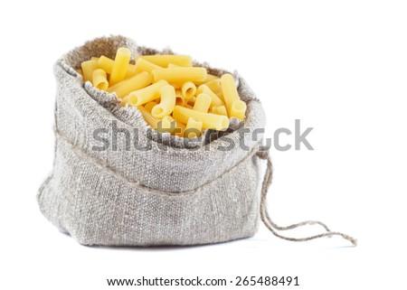 Sack with pasta isolated on white background. - stock photo