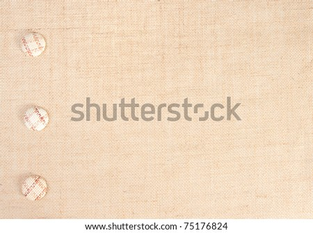 sackcloth baner with buttons as  decor. see similar in portfolio - stock photo