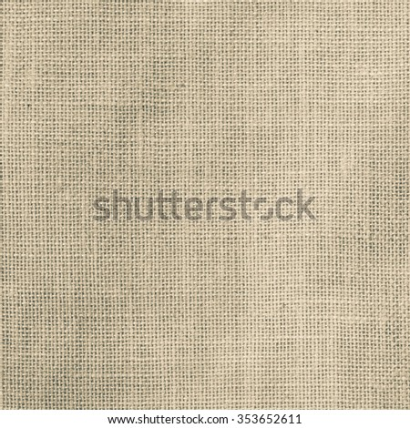 Sackcloth woven texture pattern background in light two-tone sepia brown green color tone: Eco friendly raw organic flax sack cloth fabric textile: Bag rope thread detailed textured burlap canvas  - stock photo