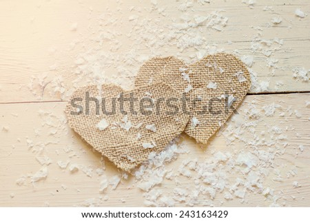 Sacking hearts  on the old board - stock photo
