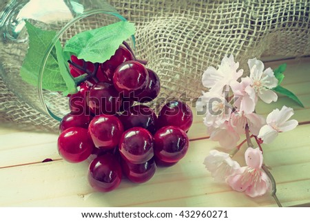 sacks and grapes and pink flower on wood background.effcet vinta - stock photo
