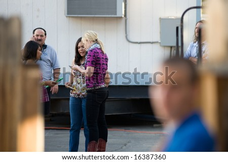 SACRAMENTO, CA - August 20: Natasha Bedingfield (C) signs autographs before her show at the California State Fair. August 20, 2008