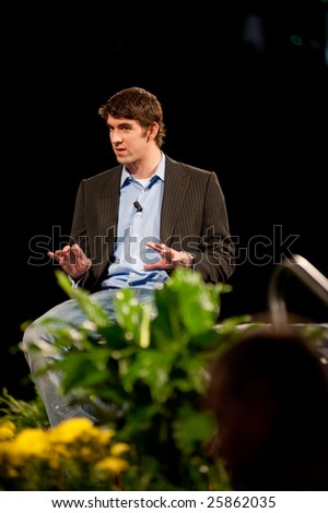 "SACRAMENTO, CA - February 24, 2009: Michael Phelps speaking at a ""Get Motivated"" Seminar at the Arco Arena in Sacramento, California. - stock photo"