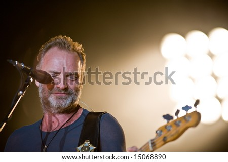 Sacramento, CA - July 17,2008: Singer Sting performs on-stage at the Sleep Train Amphitheater in Marysville, CA with The Police in their North American Reunion Tour - stock photo