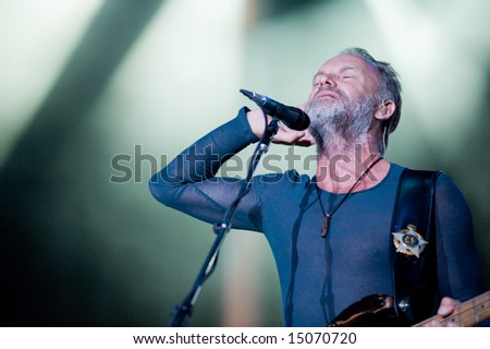 Sacramento, CA - July 17,2008: Singer Sting performs onstage at the Sleep Train Amphitheater in Marysville, CA with The Police in their North American Reunion Tour - stock photo