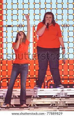 SACRAMENTO, CA - MAY 23: Lea Michele and Ashley Fink perform at the Glee Live! In Concert! tour at the Power Balance Pavilion on May 23, 2011 in  Sacramento, California. - stock photo