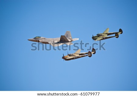 SACRAMENTO, CA - SEPT 11: Lockheed Martin F-22 Raptor and vintage P-38 Lightning aircraft fly in formation at California Capital Airshow, September 11, 2010, Mather Airport, Sacramento, CA