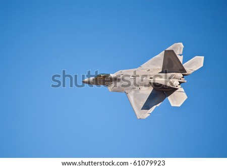 SACRAMENTO, CA - SEPT 11: Lockheed Martin F-22 Raptor performs at California Capital Airshow, September 11, 2010, Mather Airport, Sacramento, CA - stock photo