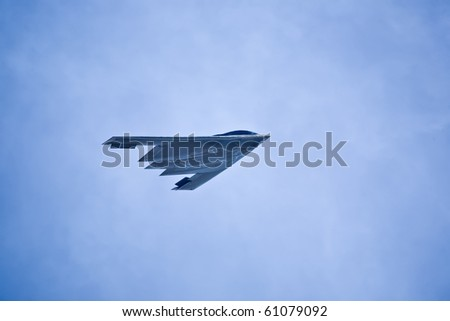 "SACRAMENTO, CA - SEPT 11: Northrop Grumman B-2 ""Spirit"" military bomber aircraft performs at California Capital Airshow, September 11, 2010, Mather Airport, Sacramento, CA - stock photo"