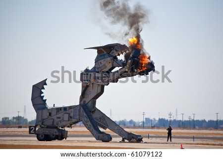 SACRAMENTO, CA - SEPT 11: Robosaurus performs at California Capital Airshow, September 11, 2010, Mather Airport, Sacramento, CA - stock photo