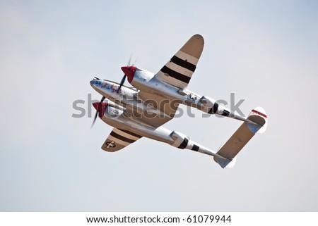 "SACRAMENTO, CA - SEPT 11: Vintage P-38 Lightning ""Honey Bunny"" flies at California Capital Airshow, September 11, 2010, Mather Airport, Sacramento, CA - stock photo"