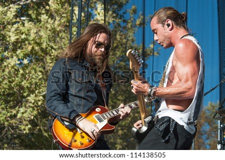 SACRAMENTO, CA - SEPTEMBER 23: Chris Traynor (L) and Gavin Rossdale of Bush perform as part of the Aftershock Music Festival at Discovery Park on September 23, 2012 in Sacramento, California. - stock photo