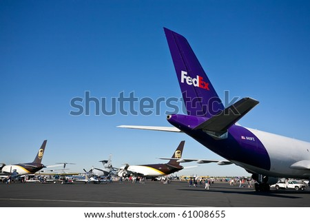 SACRAMENTO, CA - SEPTEMBER 11: FedEX and UPS cargo aircraft on display at California Capital Airshow, September 11, 2010, Mather Airport, Sacramento, CA - stock photo