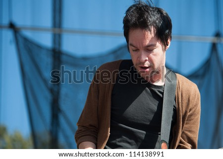 SACRAMENTO, CA - SEPTEMBER 23: Pete Loeffler of Chevelle performs as part of the Aftershock Music Festival at Discovery Park on September 23, 2012 in Sacramento, California. - stock photo