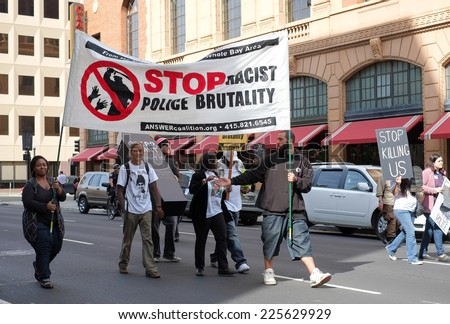 SACRAMENTO, CALIFORNIA - October 22: Protesters march to demonstrate against police brutality in Sacramento, California on October 22, 2014