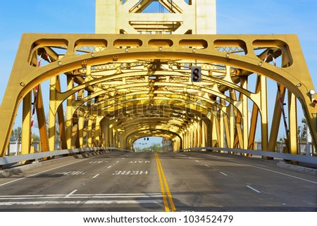 Sacramento Golden Tower Bridge from front looking through - stock photo