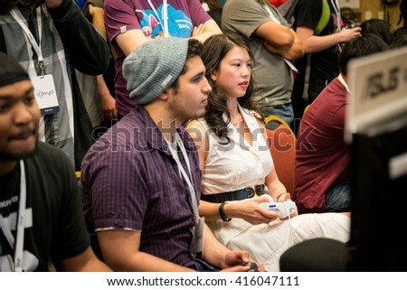 SACRAMENTO - MARCH 26: Unidentified female gamer playing at Super Smash Bros. video game competition on March 26, 2016 at NCR NorCal Regionals, the premier fighting game tournament. - stock photo