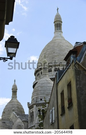 Sacre-Coeur Basilica's dome view from an alley