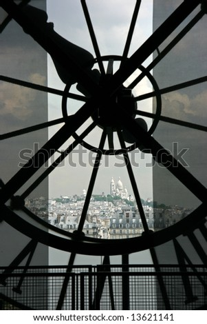 Sacre Coeur basilique in Montmartre seen though the clock on top of Orsay Museum in Paris - stock photo