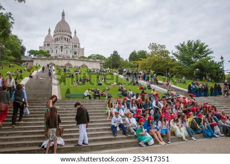 Sacre-Coeur, Paris - June 26, 2013 : Teenager taking group photo - stock photo