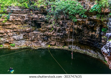 """Sacred Cenote (""""sacred well"""" or """"Well of Sacrifice""""). Chichen Itza archaeological site, Yucatan peninsula, Mexico. - stock photo"""